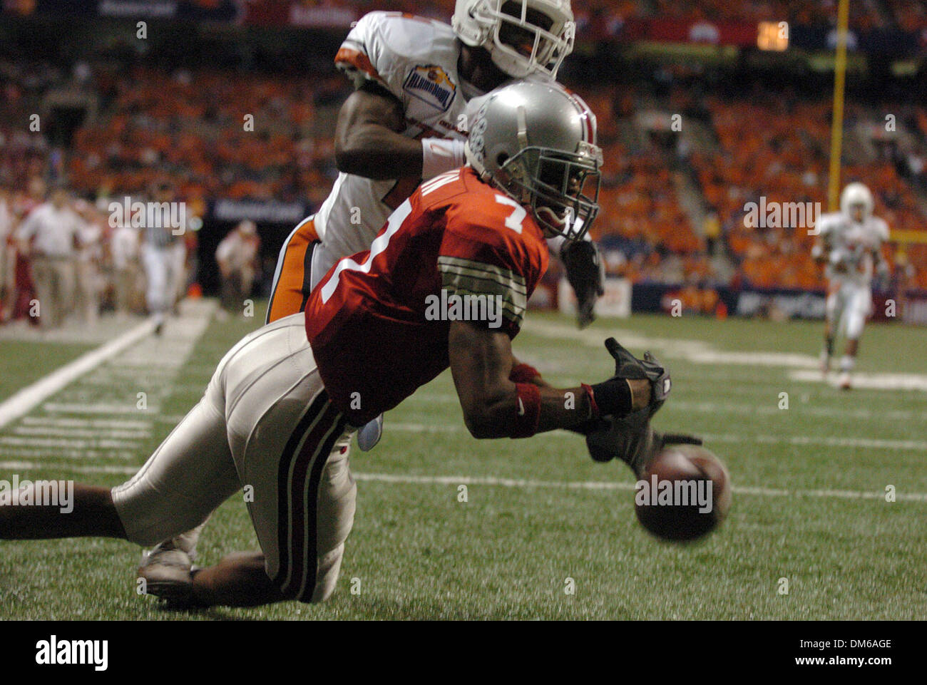Dec 29, 2004; San Antonio, TX, USA; NCAA Football - Oklahmoaa States' Daniel McLemore (top)is called for pass interference as he has contact with Ohio State's Ted Ginn during the 2004 MasterCard Alamo Bowl in the Alamo Dome in San Antonio. - Stock Image