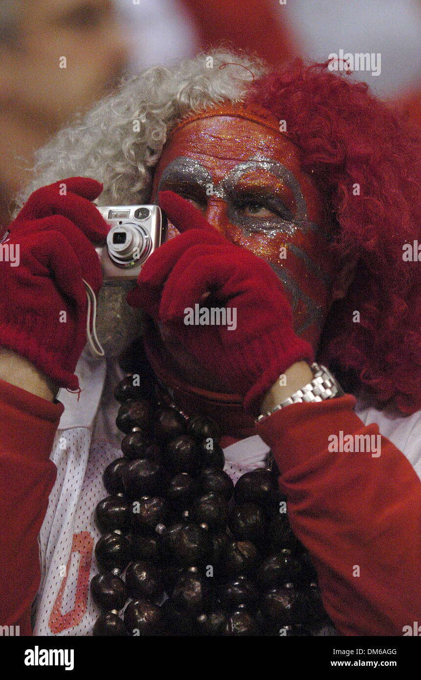 Dec 29, 2004; San Antonio, TX, USA; NCAA Football - Ohio State fan Larry Lokai take a photo wearing his school's colors during the 2004 MasterCard Alamo Bowl in the Alamo Dome in San Antonio. - Stock Image