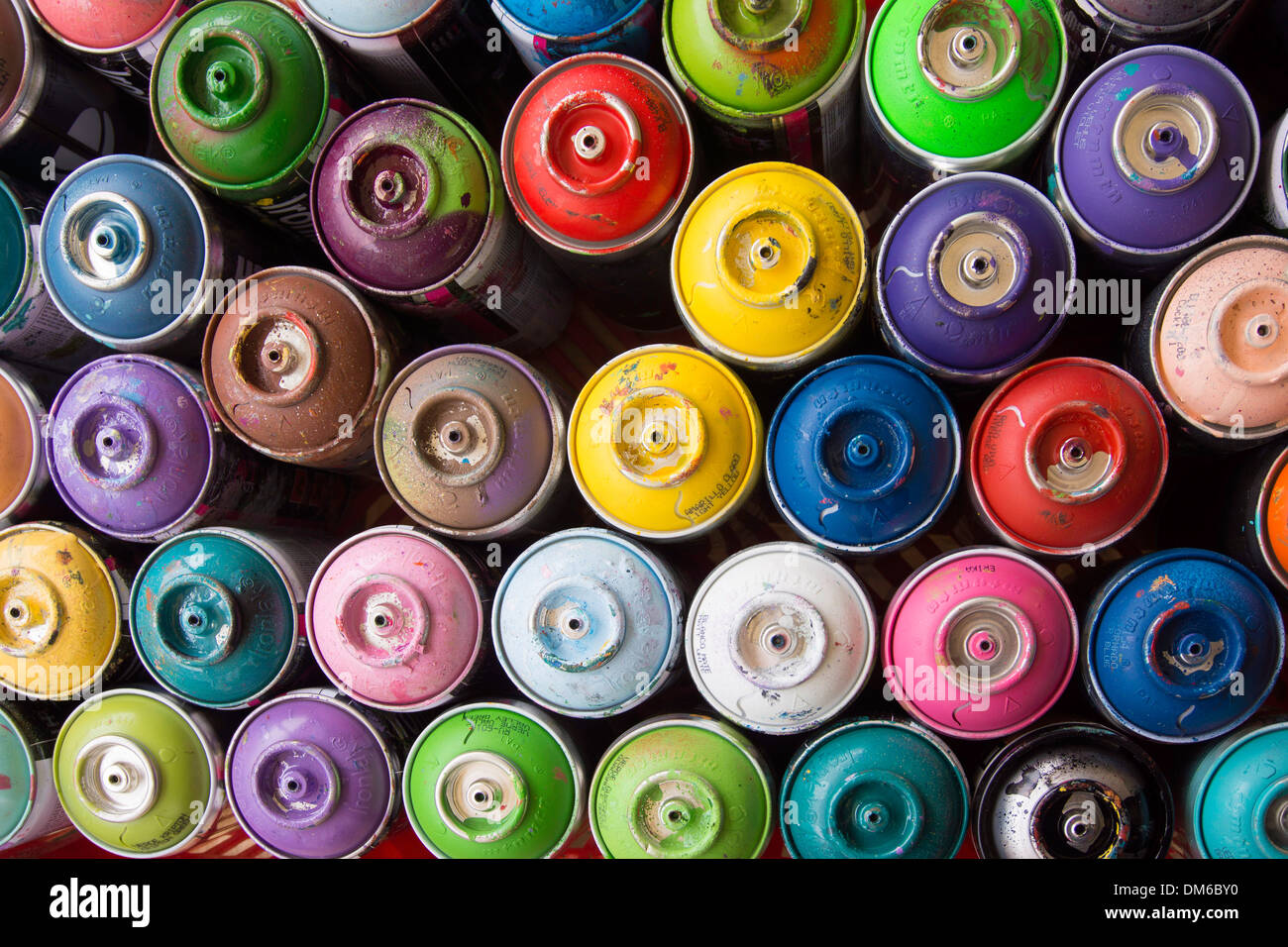 Coloured spray paint cans - Stock Image
