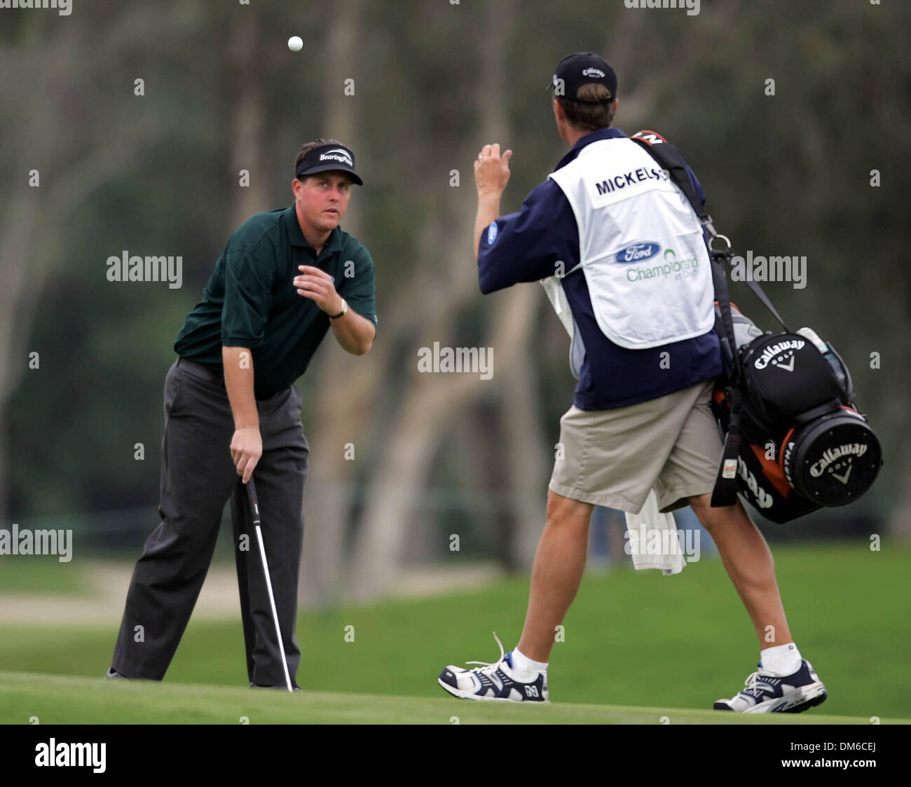 Mar 03, 2005; Miami, FL, USA; PHIL MICKELSON tosses his ball to his caddie after making a bogey on the 10th hole. Stock Photo