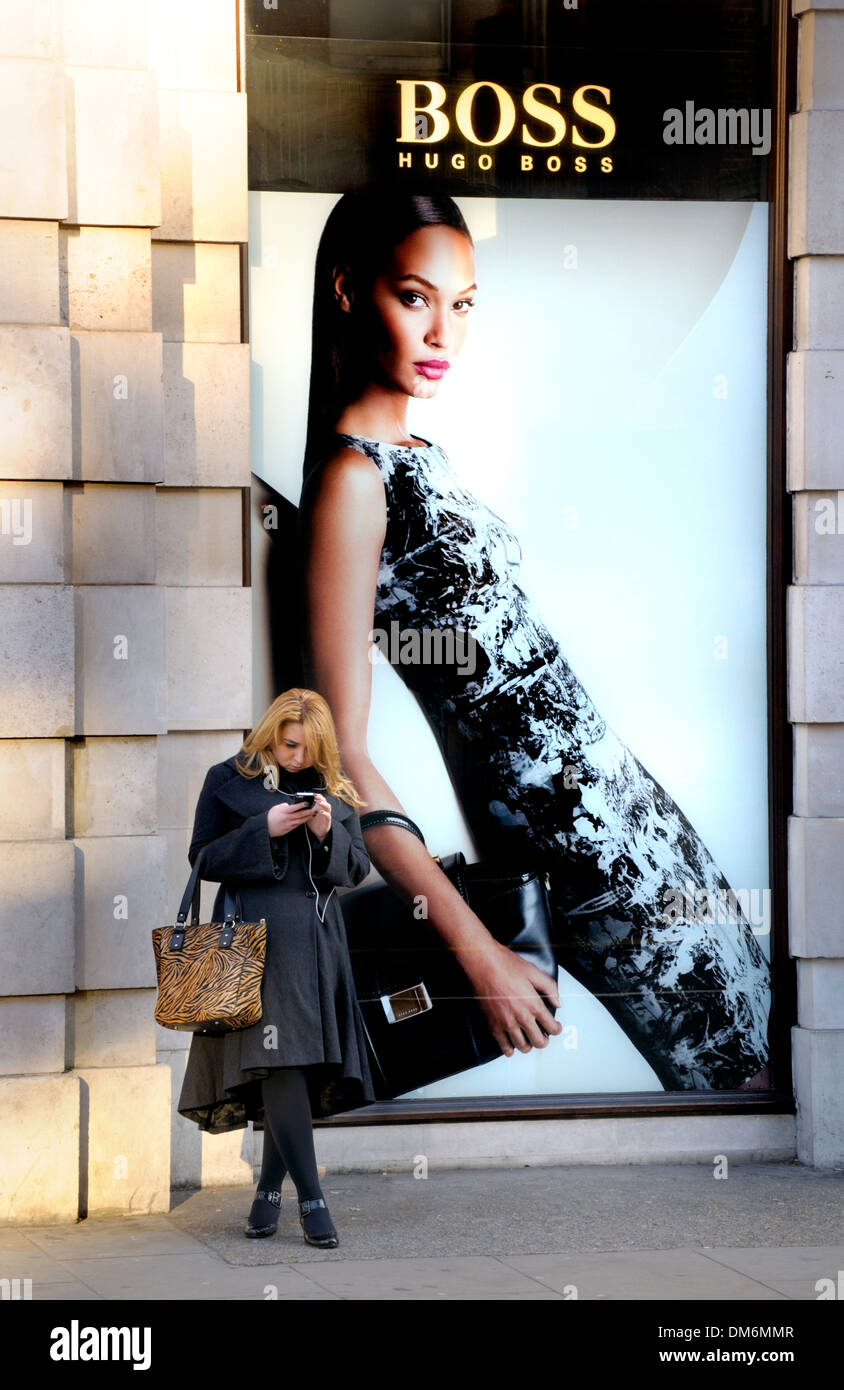 London, England, UK. Hugo Boss shop on Sloane Square. Poster featuring model Joan Smalls (Puerto Rico) - Stock Image