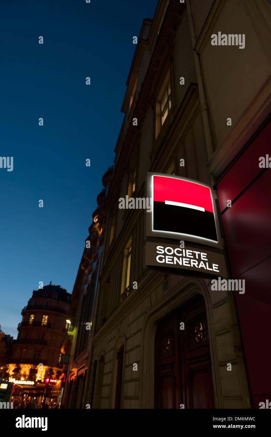 Paris, France - branch of Societe Generale bank - sign illuminated at night - Stock Image