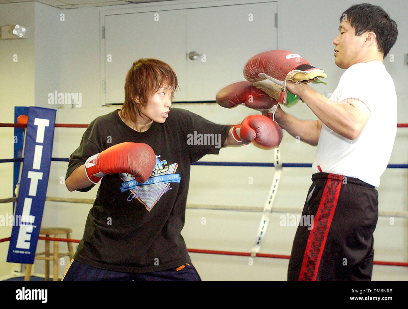 Aug 16, 2005; San Antonio, TX, USA; Sachiyo Shibata gets in a short workout with her trainer Masahiro Hada, on Tuesday August 15, 2005 at the Family Fitness Center on S.W. Military. Shibata, of Japan, is in town this week, set to fight San Antonio's Maribel Zurita Friday in a women's world title bout at Municipal Auditorium.  Mandatory Credit: Photo by Helen L. Montoya/San Antonio  - Stock Image