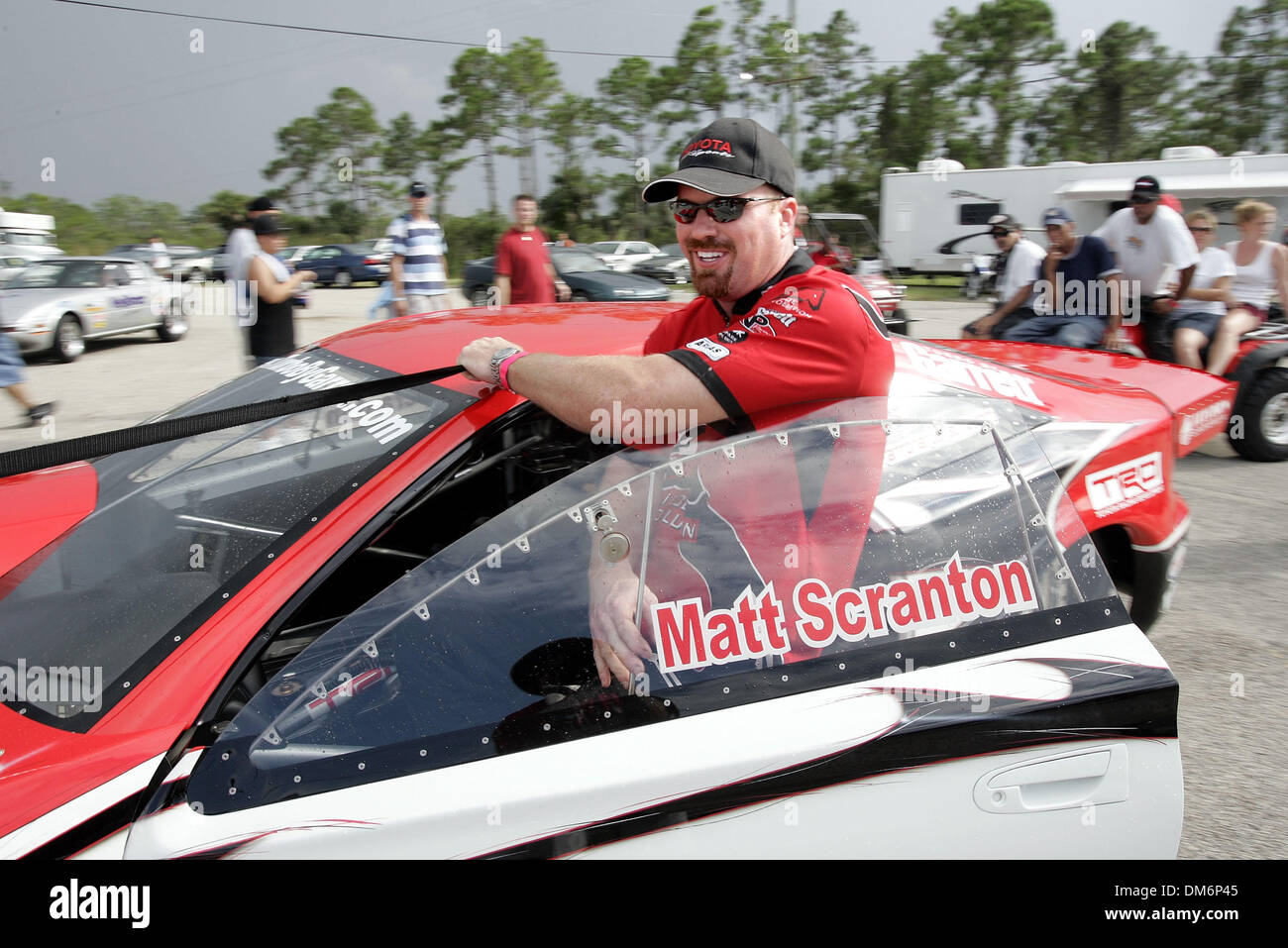 Aug 21, 2005; Palm Beach, CA, USA; MATT SCANTRON tows his 2004 Toyota Celica back to his trailor as rain storms approach, suspending races during the Palm Beach Sport Car Nationals at Moroso Motorsports Park on Aug. 21, 2005.  Scranton is the NHRA 2004 RWD points leading champion. Mandatory Credit: Photo by Richard Graulich/Palm Beach Post/ZUMA Press. (©) Copyright 2005 by Palm Bea - Stock Image