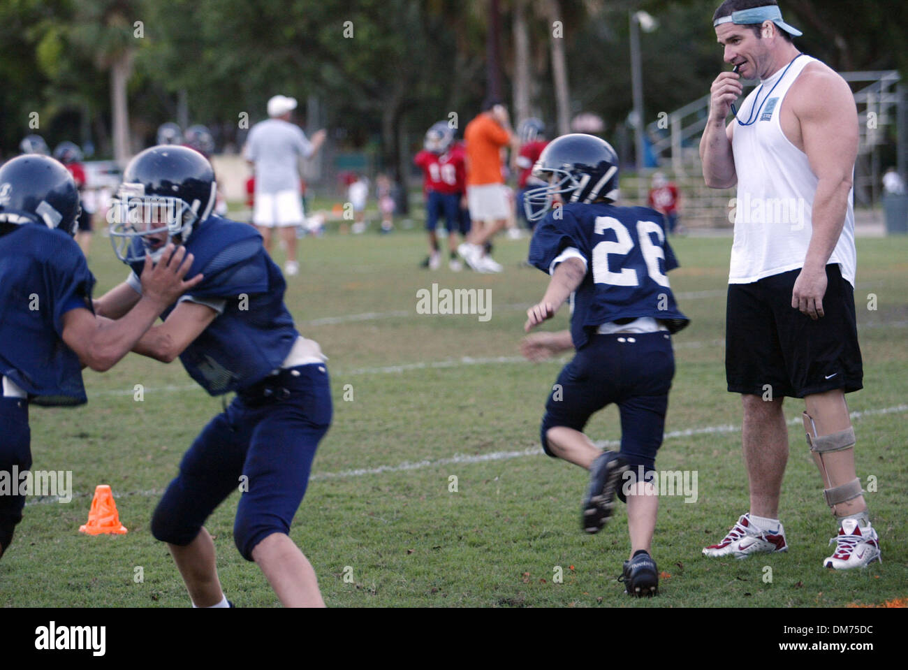 Sep 28, 2005; Boca Raton, FL, USA; Rick Busacca  (far right) is the defensive coordinator of the Boca Jets youth - Stock Image