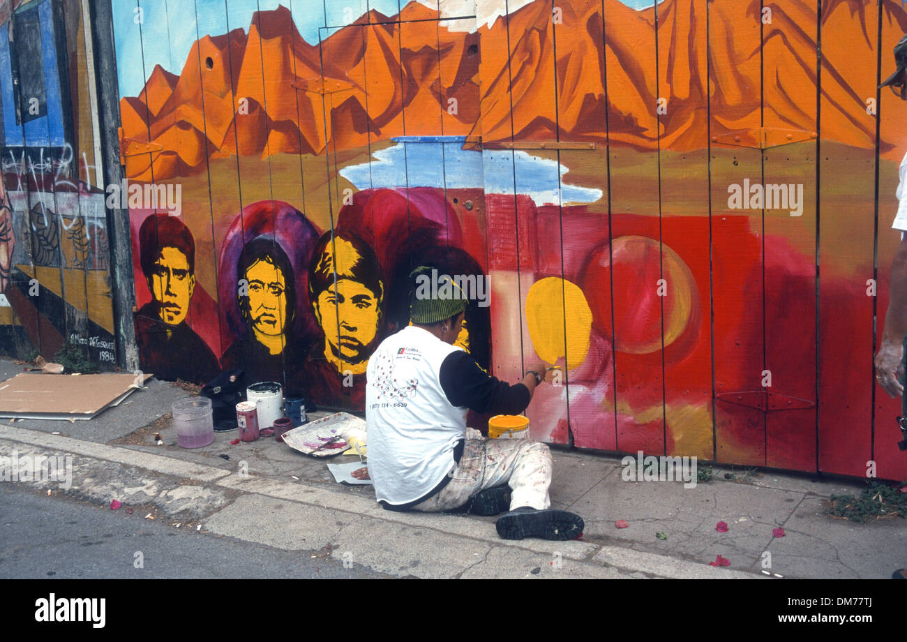 US San Francisco. A man works on a wall mural - Stock Image