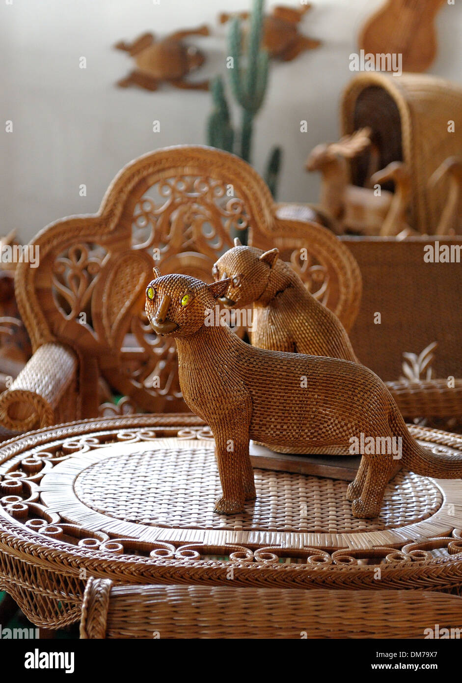 Madeira Portugal. Wicker cat souvenirs in a wicker factory shop in Camacha - Stock Image