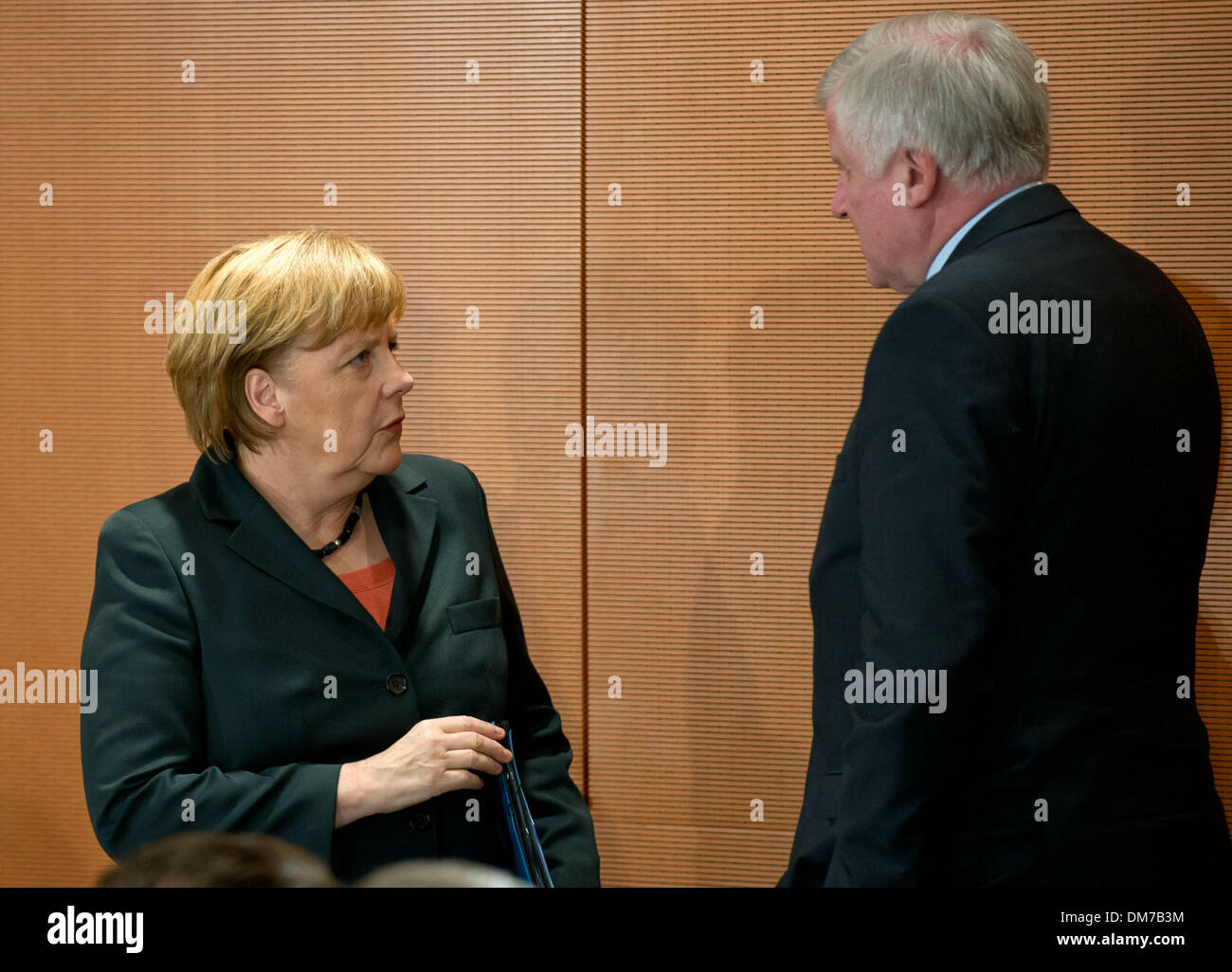 Berlin, Germany. 12th Dec, 2013. German Chancellor Angela Merkel (CDU) talks to CSU chairman and Bavarian premier Stock Photo