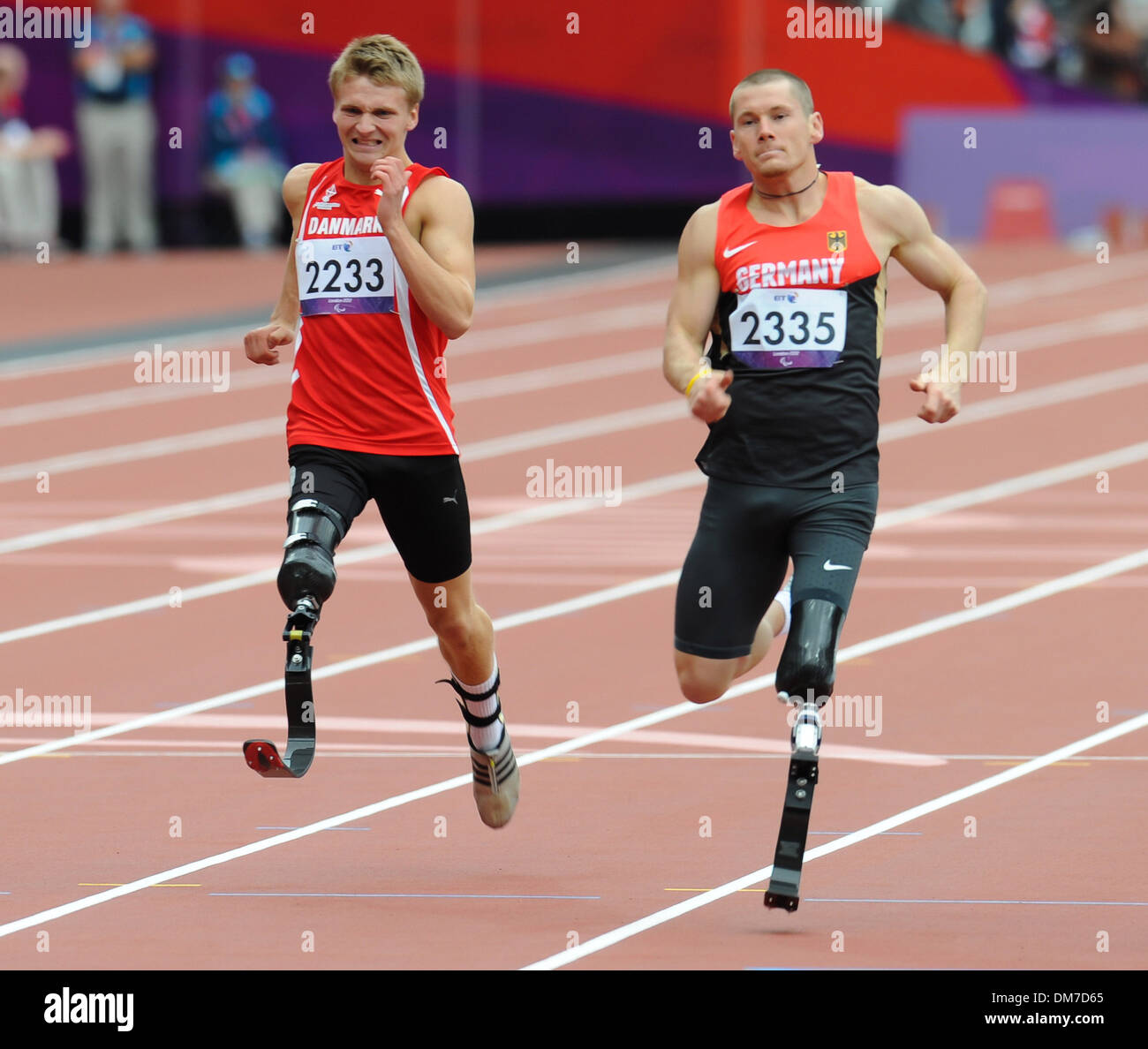 Daniel Jorgensen (Den) and Wojtek Czyz (Ger) London 2012 Paralympic Games - Men's 200m - T42 Final London England Stock Photo
