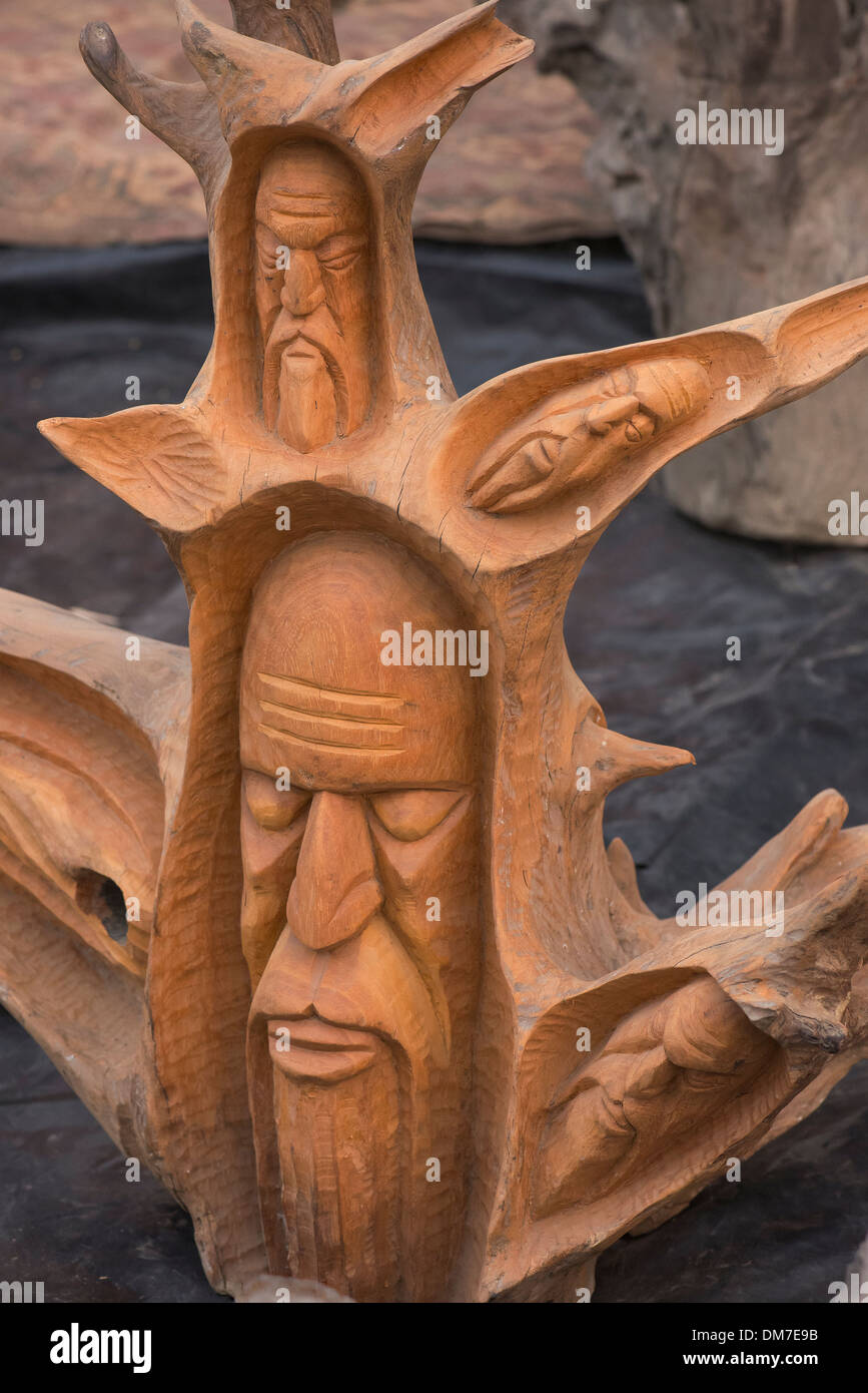 Hand Sculpture [RM] on wood of all old wise men . - Stock Image