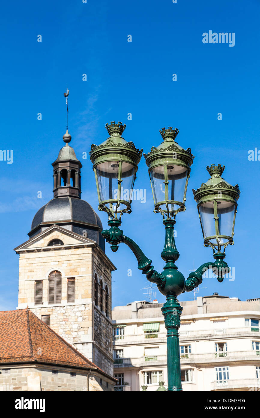 Church bell tower and ornate lamps, Annecy, Savoie, France - Stock Image