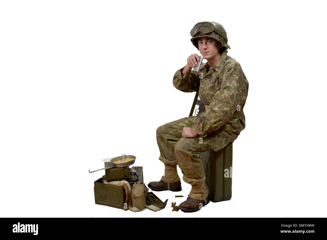 young American soldier in camouflage uniform drink - Stock Image