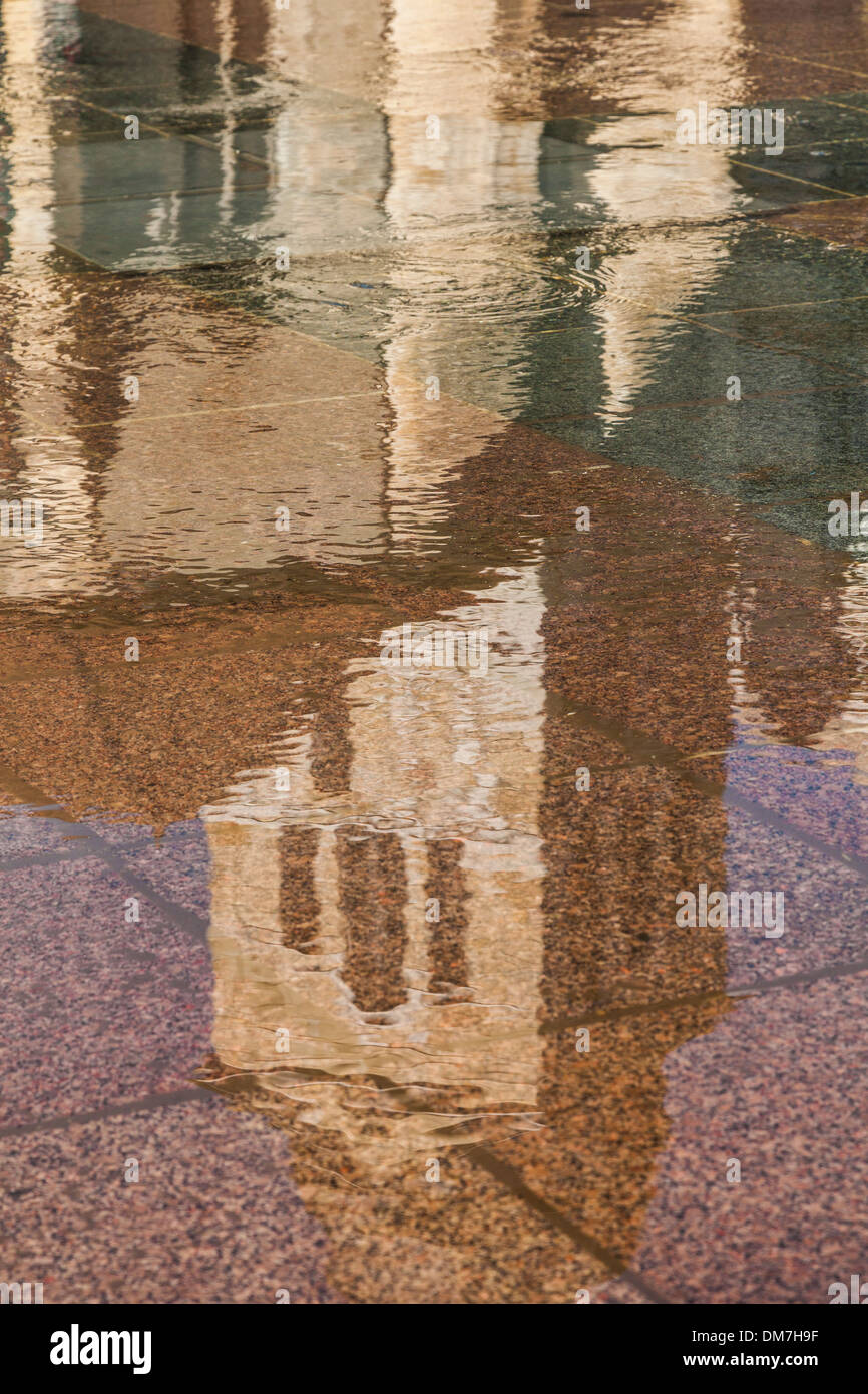 Church reflected in water reflecting pool in Annecy, Savoie, France - Stock Image