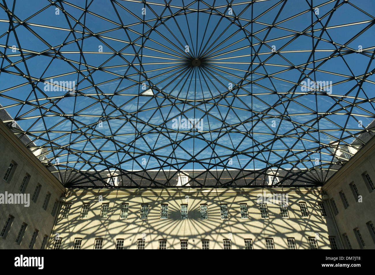 Glass roof designed as a compass card casts geometrical shadows on courtyard facade of the naval museum in Amsterdam - Stock Image