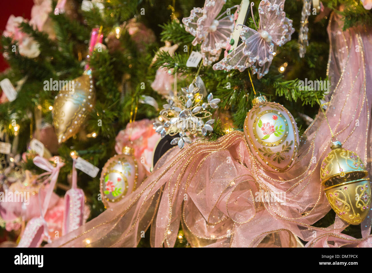 Gold And Pink Christmas Decorations Ribbon On A Richly Decorated Xmas Tree