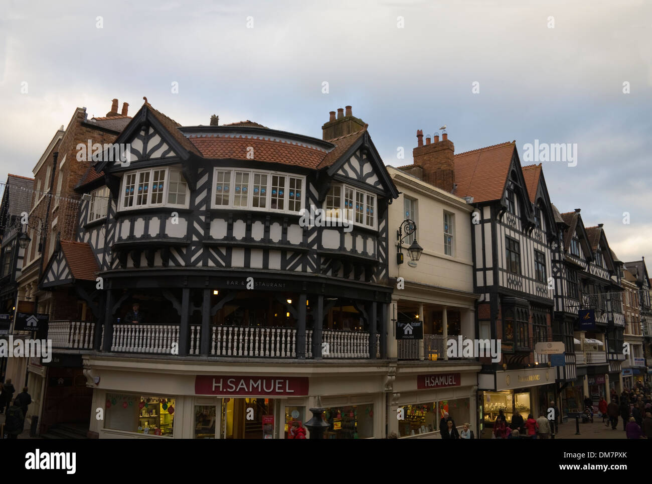 Chester Cheshire England UK Half timbered buildings housing shops in city centre - Stock Image