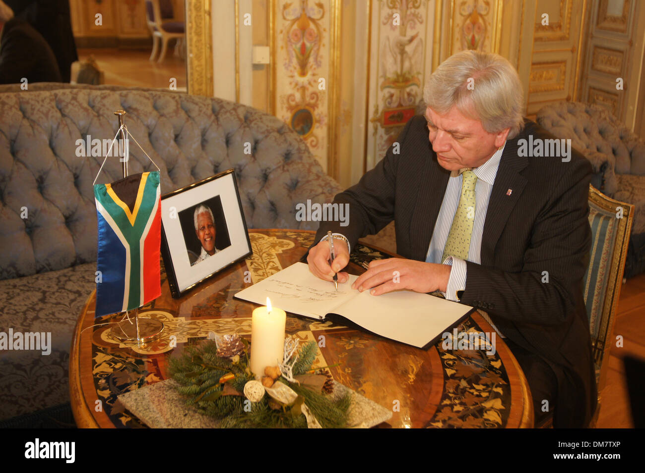 Volker Bouffier, Minister-President of Hesse signs the condolences book of the parliament of Hessen for Nelson Mandela. With the sign of all members of the parliament, the bokk will handover to the General consulate of South-Africa. - Stock Image