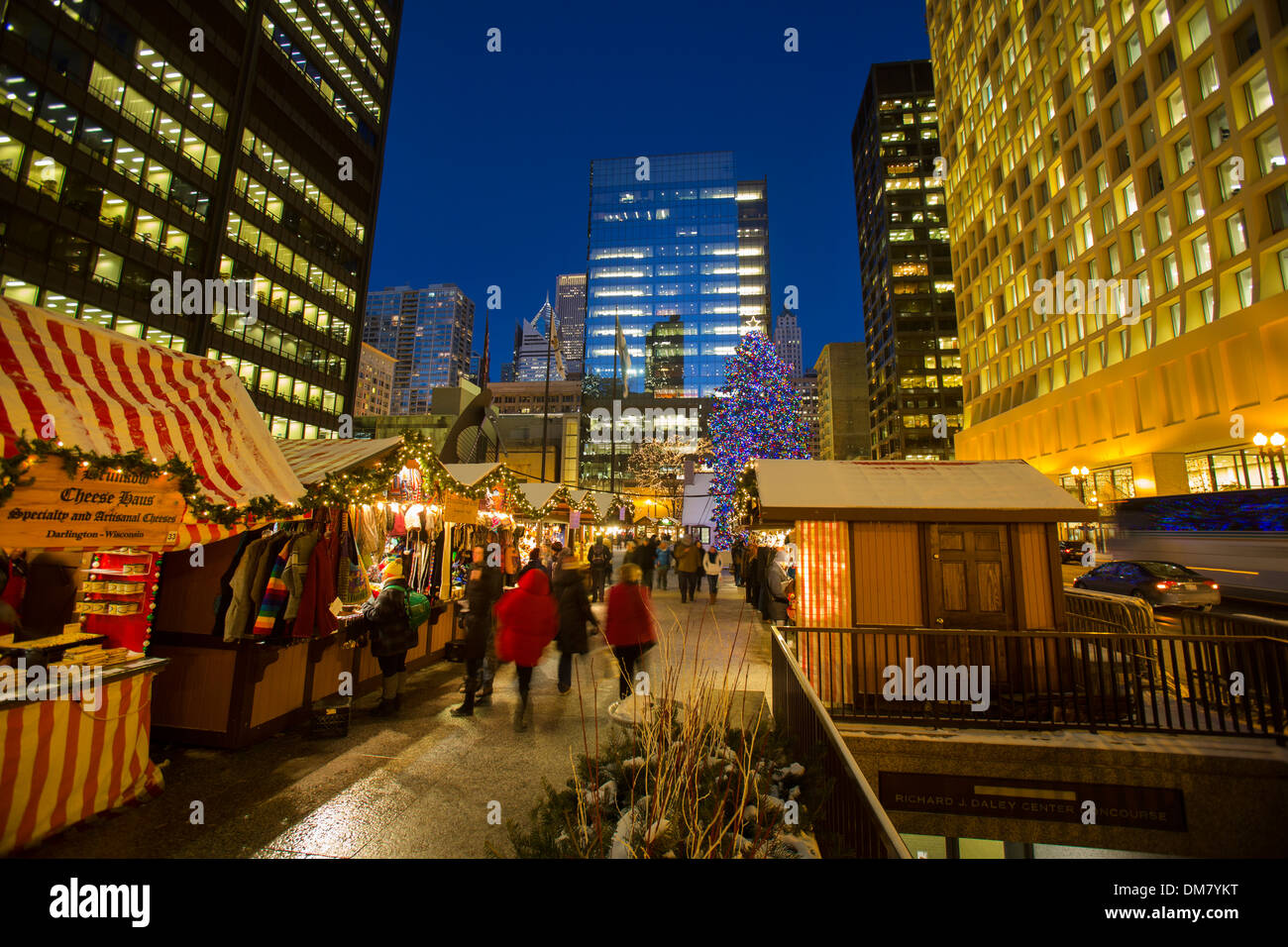 shoppers at chicago german christkindlmarket winter festival open air outdoor holiday season market loop german