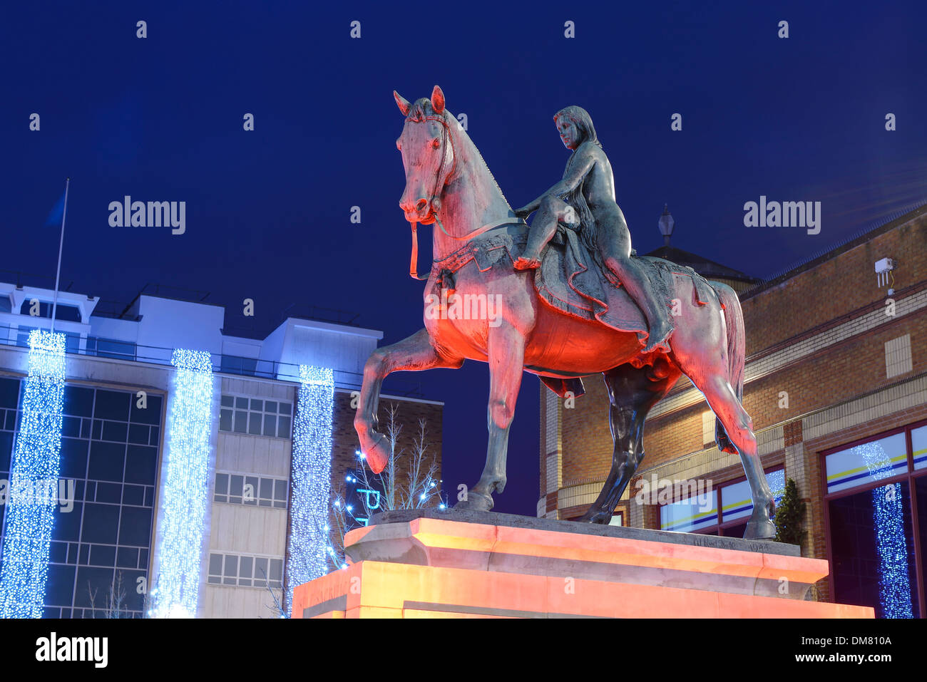 The Lady Godiva statue in Coventry city centre lit up at night - Stock Image