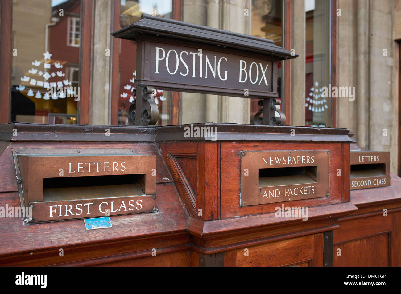 Old fashioned wooden posting box outside the main Post Office in Oxford city centre - Stock Image