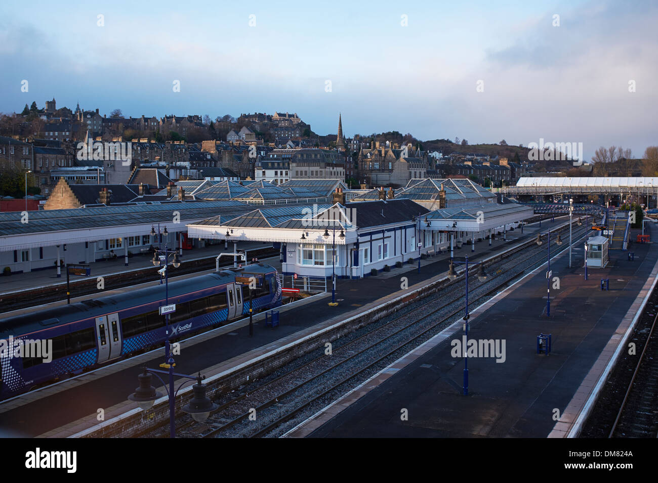 Stirling railway station with the Castle and city centre in the distance - Stock Image