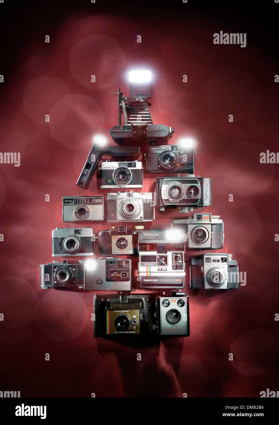 Old retro cameras in the shape of a Christmas tree - Stock Image