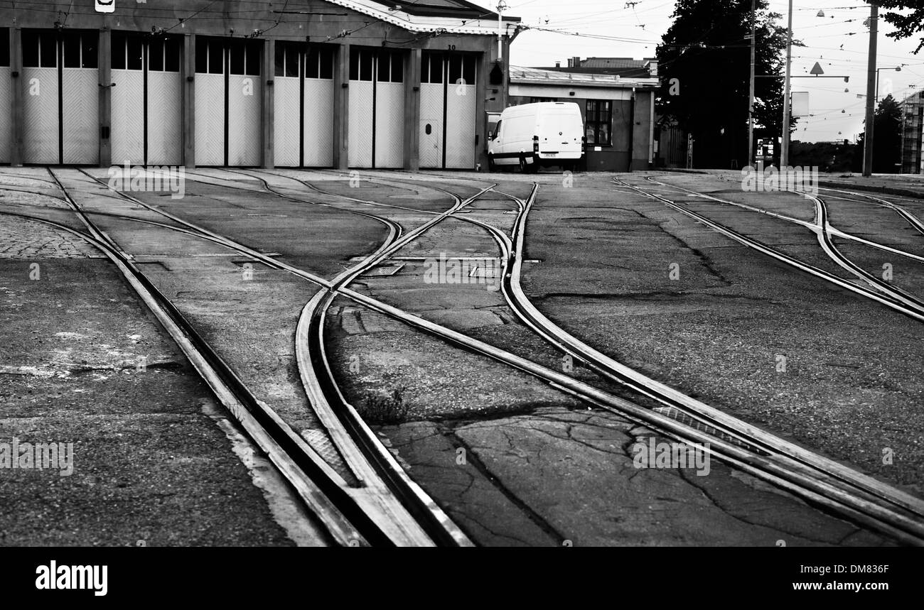 Rails leading into a repair hall for trams in Helsinki - Stock Image
