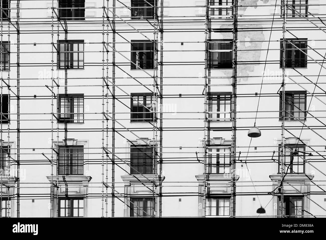 Scaffoldings on the side of an apartment building - Stock Image