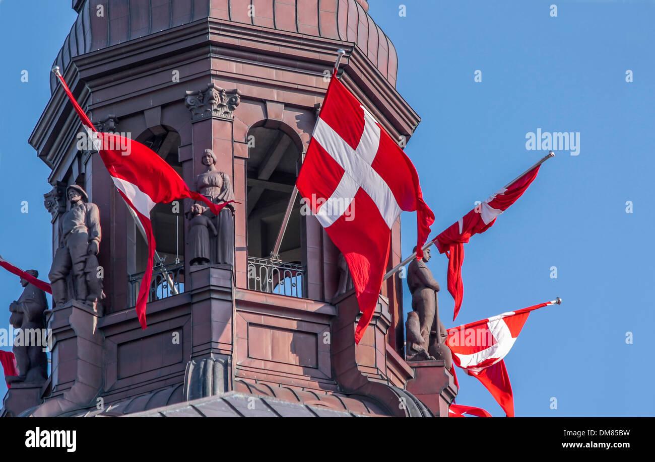 Tower of Christiansborg Castle with Danish flag in Copenhagen, Denmark - Stock Image