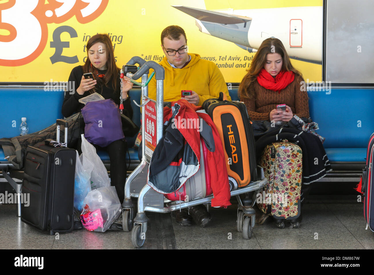 DELAYED PASSENGERS AT STANSTED AIRPORT ESSEX ON SATURDAY LUNCHTIME DEC 7TH  AFTER AN AIR TRAFFIC CONTROL FAULT. - Stock Image
