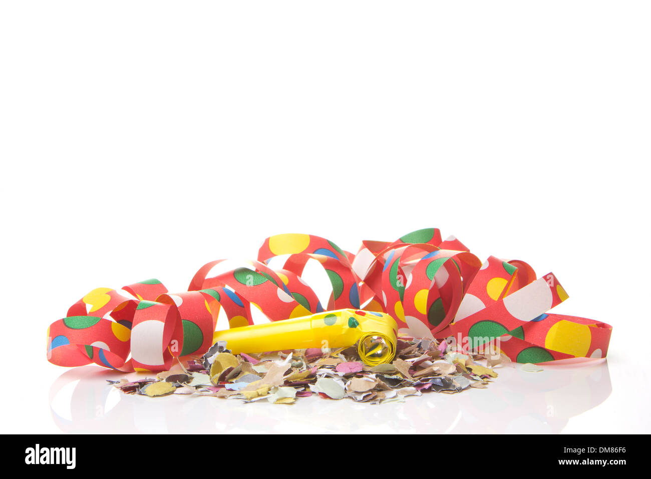 streamers and confetti as decoration for parties, sylvester with white background - Stock Image