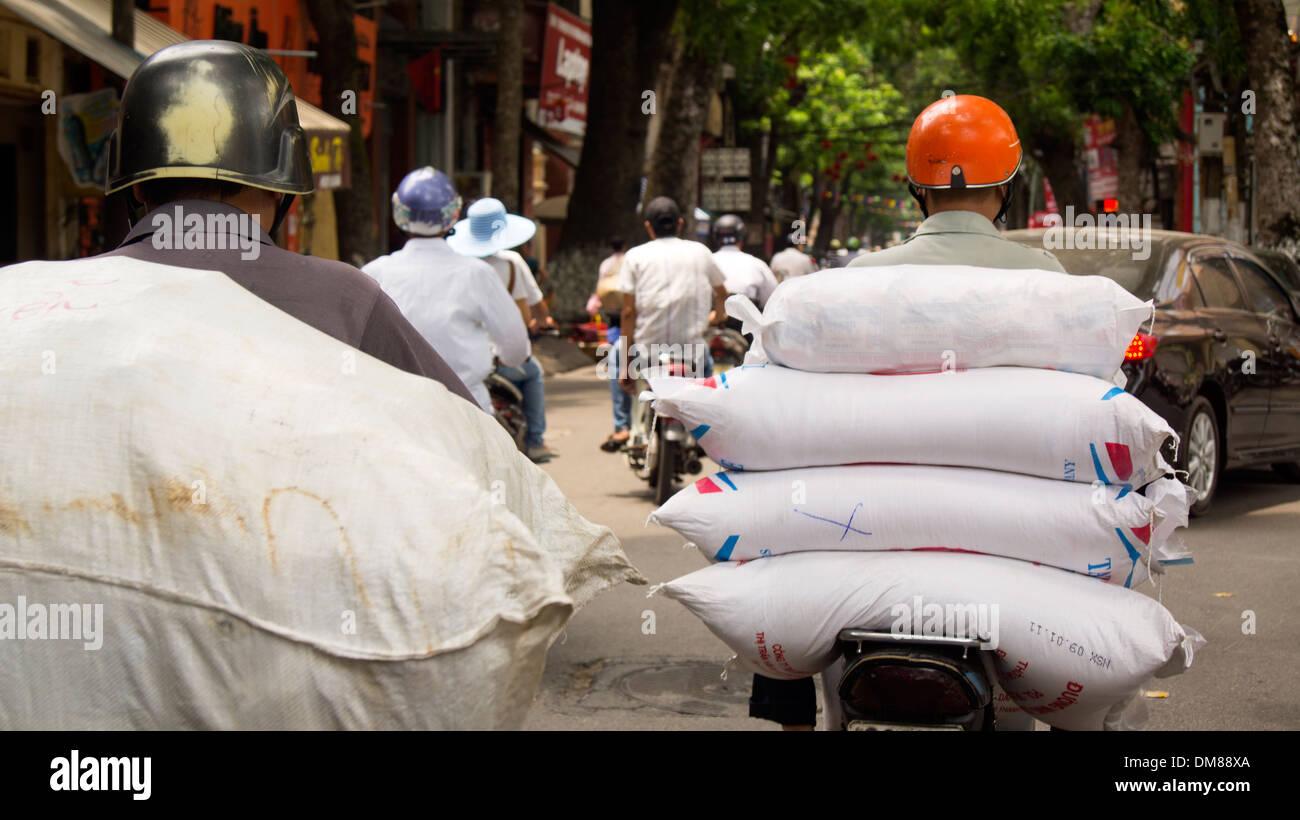 Sacks of rice on Motorbike Market Hanoi Vietnam South East Asia - Stock Image