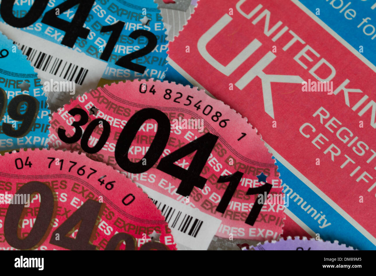 Car Registration Certificate with Various Car Tax Discs 2007 to 2013 Stock Photo