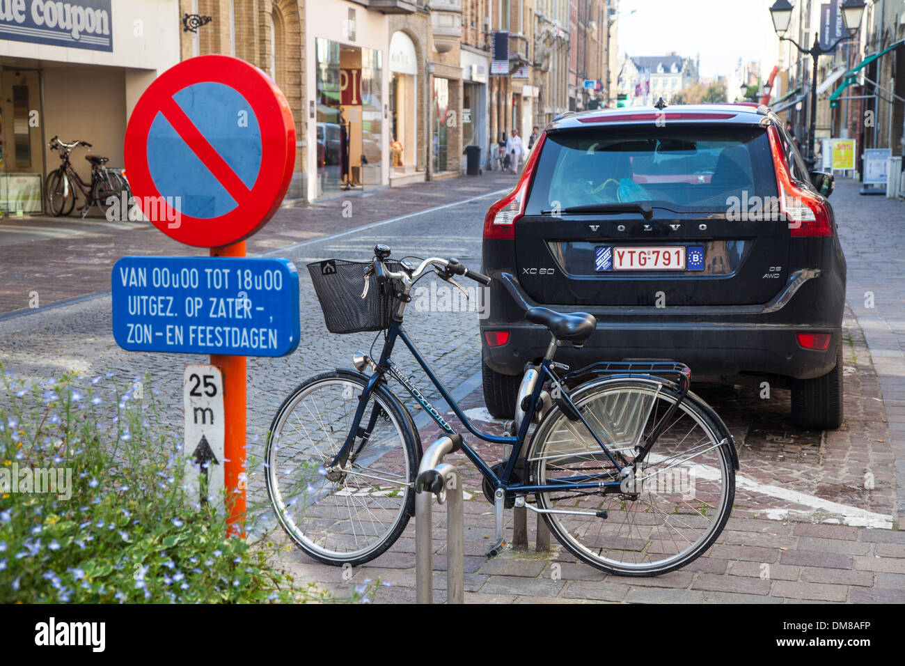 Parked car and bicycle parked in a rack in Ypres, Belgium Stock Photo