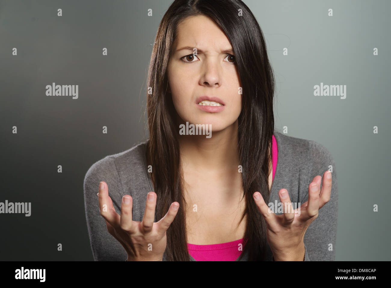 Young woman with a horrified expression Stock Photo