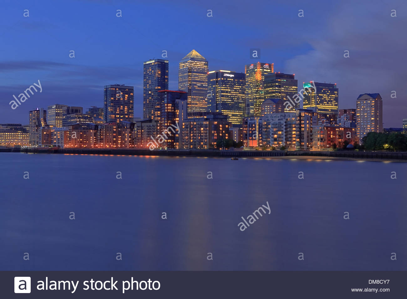 Canary Wharf , on the Isle of Dogs, at twilight as seen from Deptford south London. Canary Wharf tower dominates the area - Stock Image