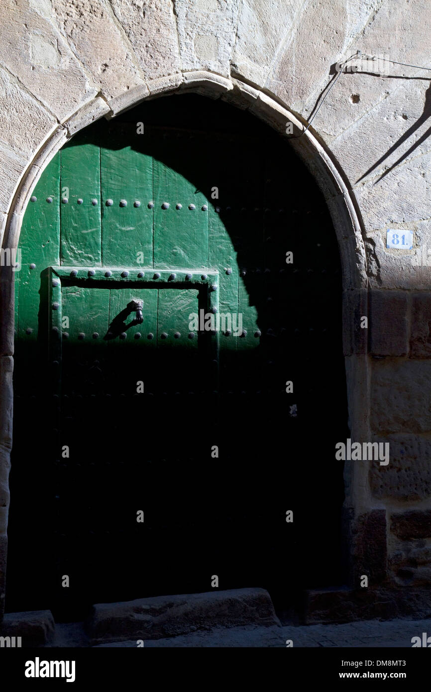Arched door at Puente La Reina a Basque town along the Way of St. James pilgrimage route, Navarra, Spain. - Stock Image