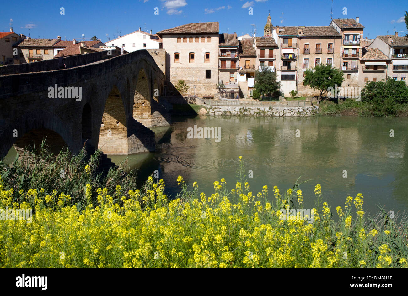 Six-arched Roman bridge spanning the Arga River on the Way of St. James pilgrimage route in Puente La Reina, Navarra, Spain. - Stock Image