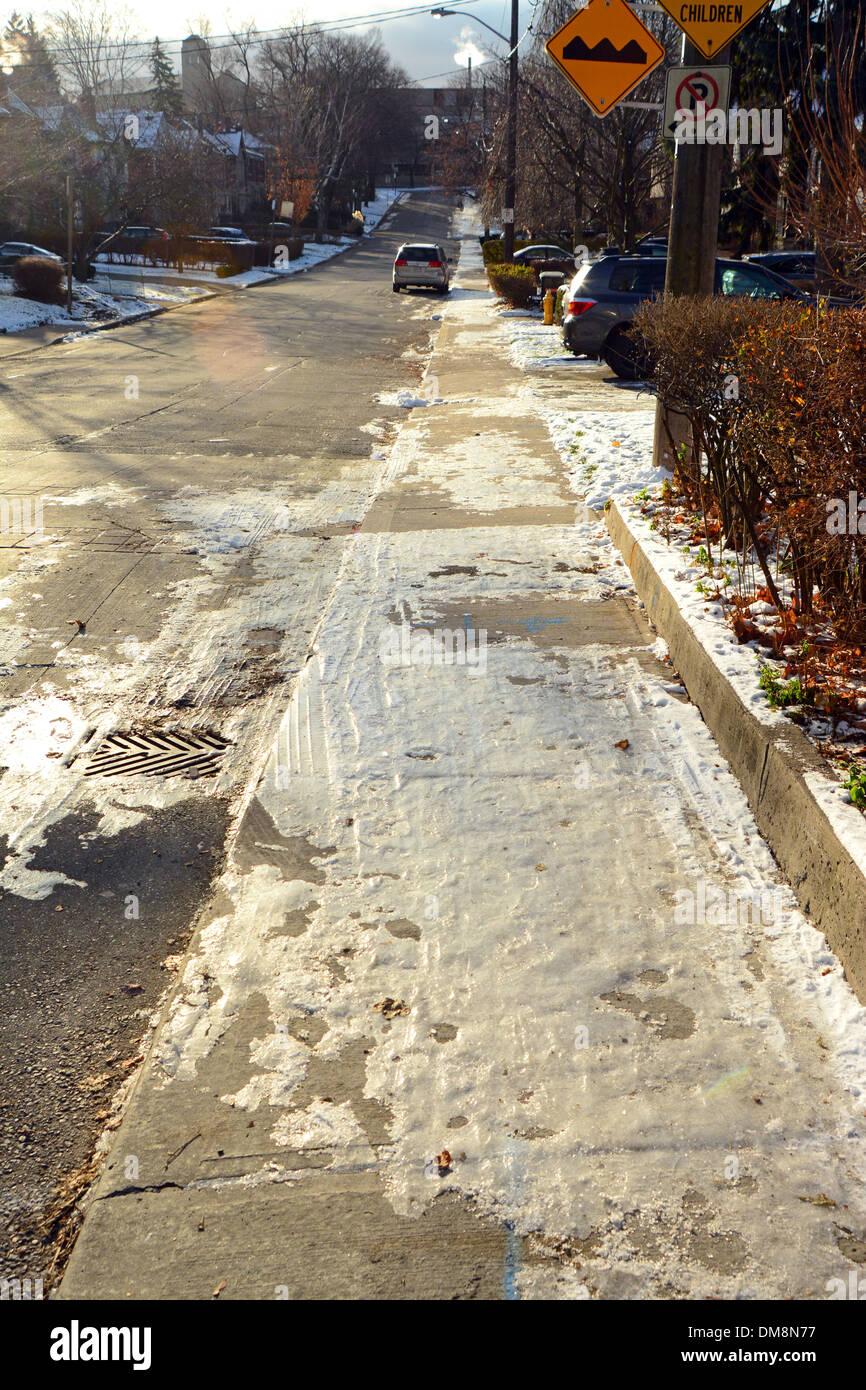Icy sidewalk Toronto, Canada - Stock Image