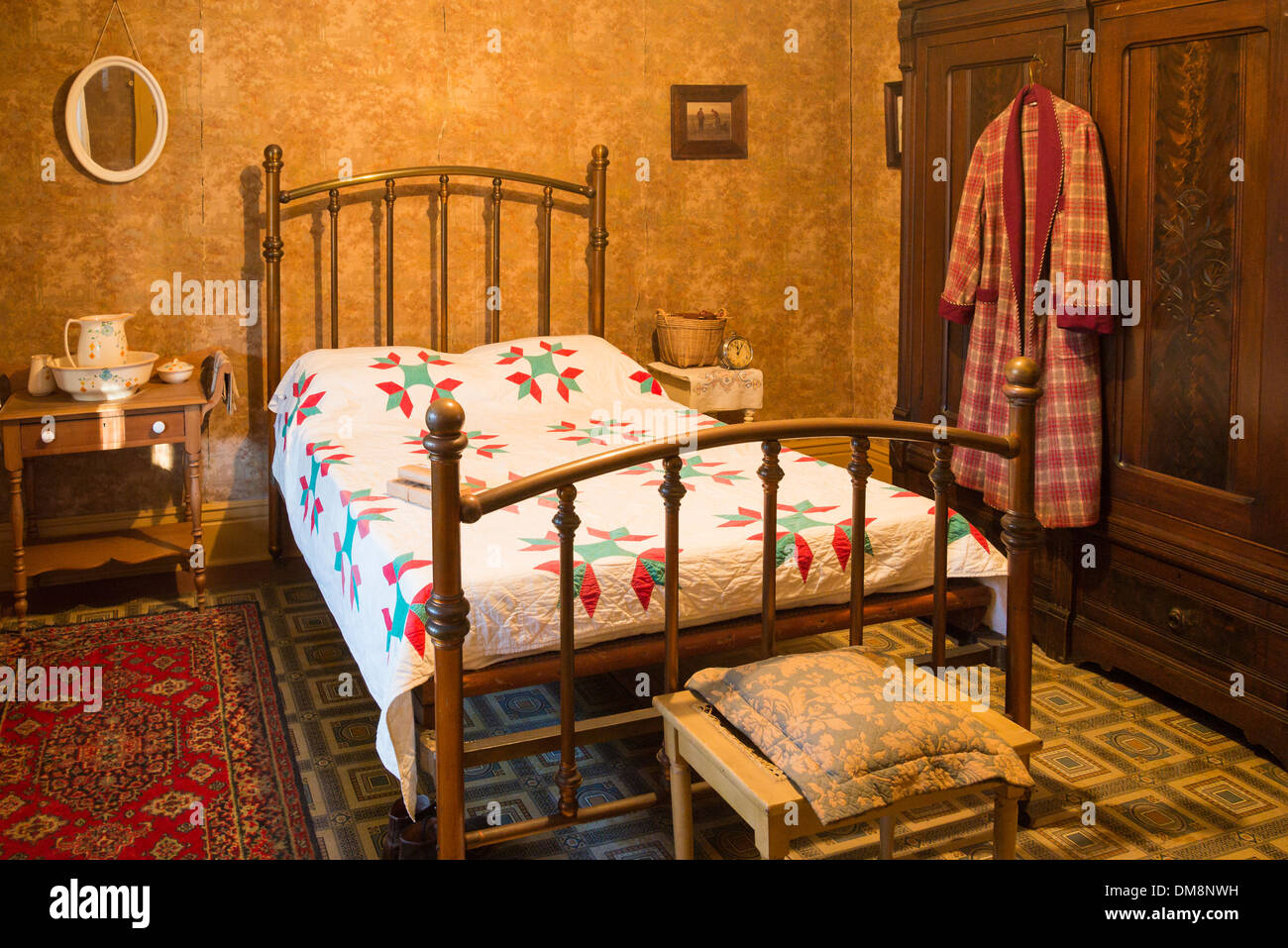 Heritage bedroom with brass bed and quilt, Burnaby Village Museum, Burnaby, British Columbia, Canada - Stock Image