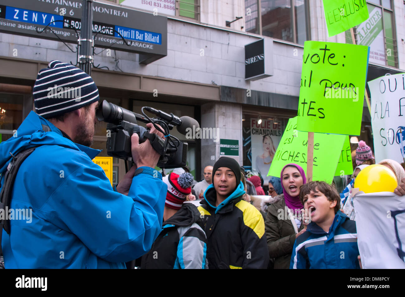 Journalist during demonstration Montreal - Stock Image