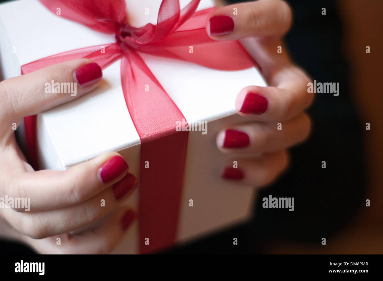 Woman offering gift - Stock Image