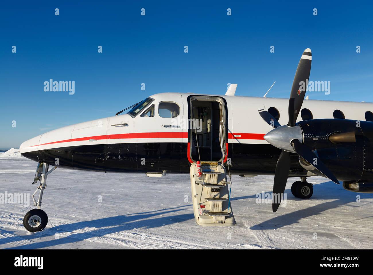 Empty Beechcraft turboprop aircraft at snow covered Barter Island LRRS airport at Kaktovik Alaska USA - Stock Image