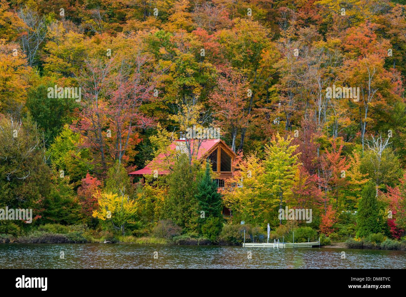 Cottage autumn Saint Adolphe de Howard Laurentians Quebec - Stock Image