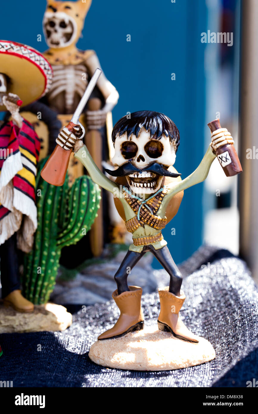 Skeleton prospector ceramic figurine - Stock Image