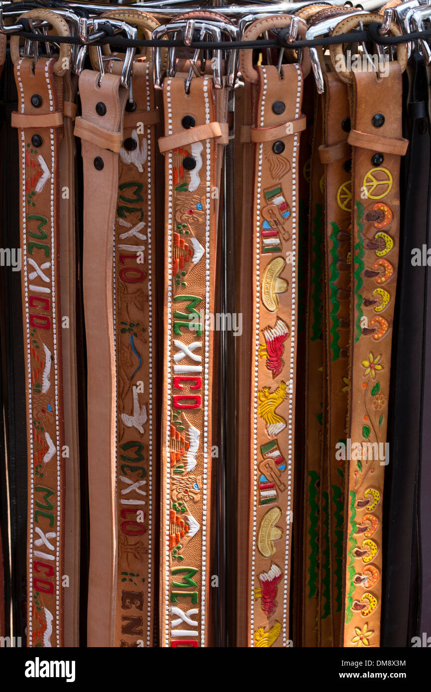 Hand painted leather belts - Stock Image