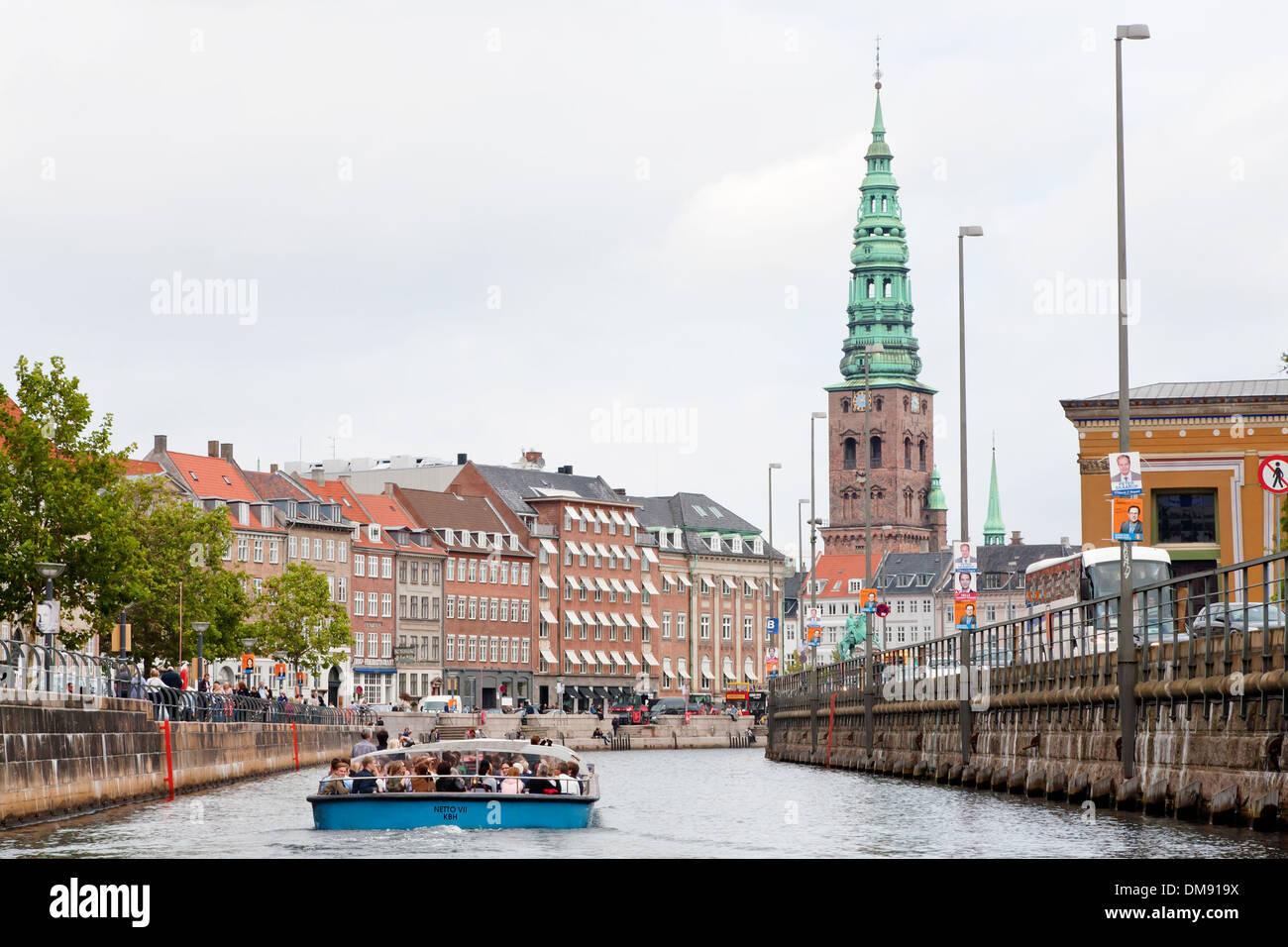 boat guided tour on Frederiksholms Kanal, in Copenhagen - Stock Image