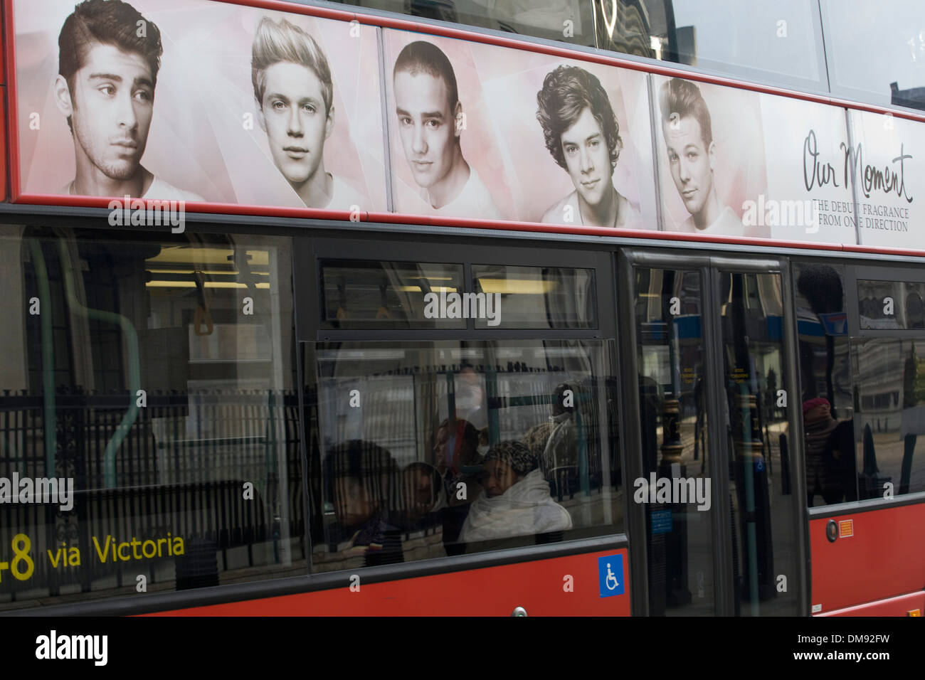 One direction 'Our Moment Fragrance' Advertisement on a London Red Bus - Stock Image