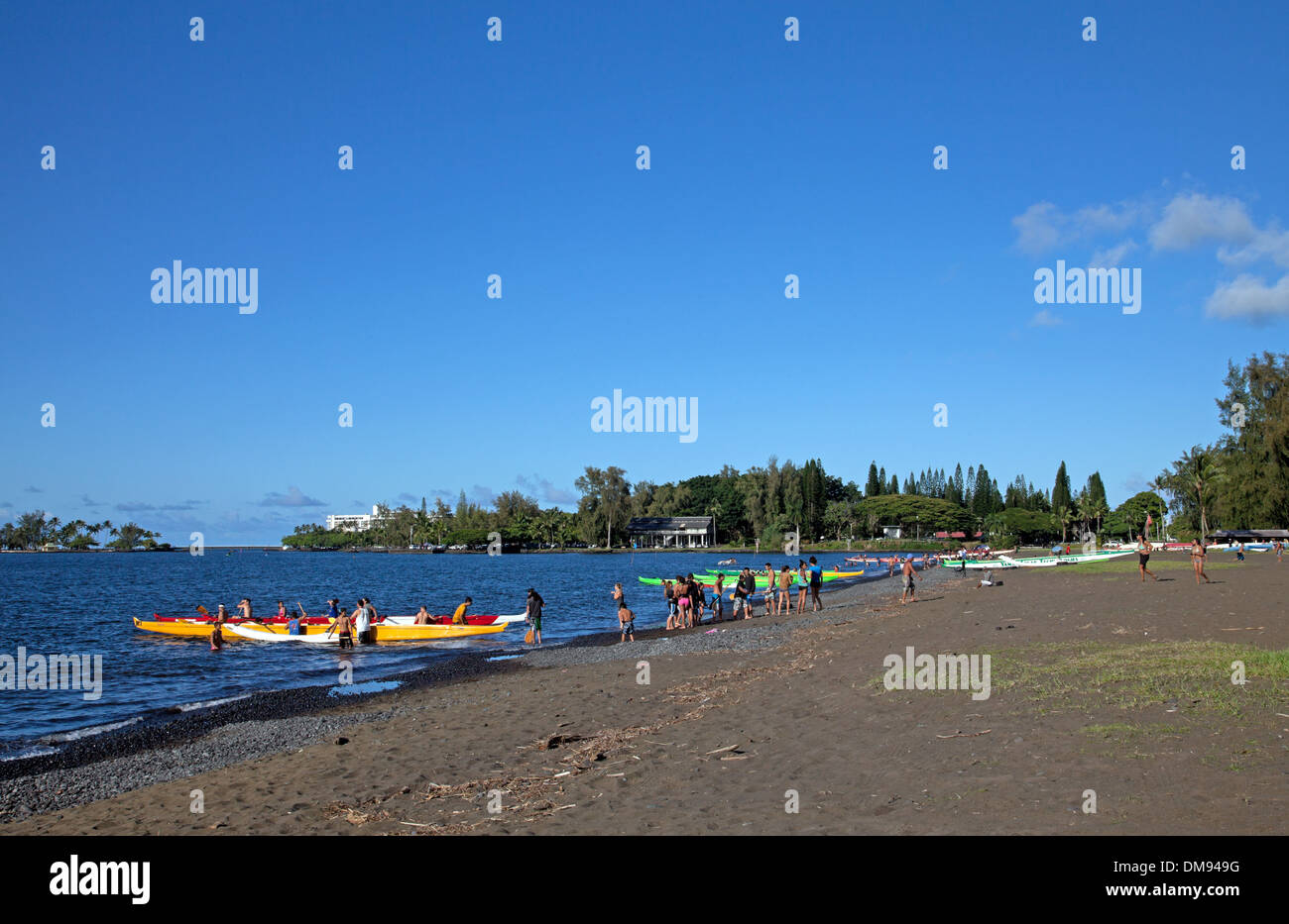 Gathering of local canoe clubs for practice time on Hilo Bay. - Stock Image