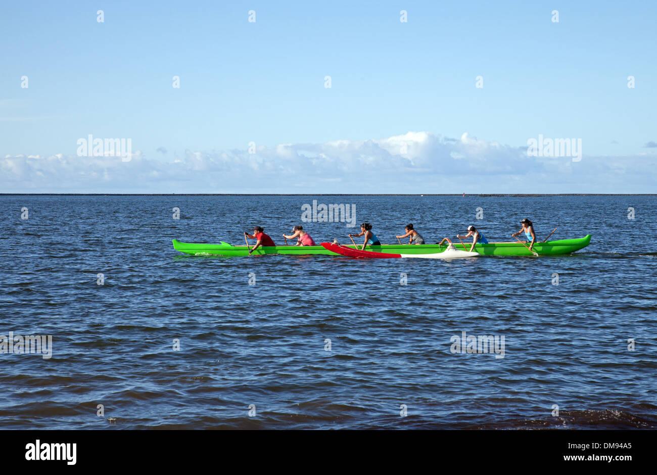 Canoe club practice race on Hilo Bay. - Stock Image